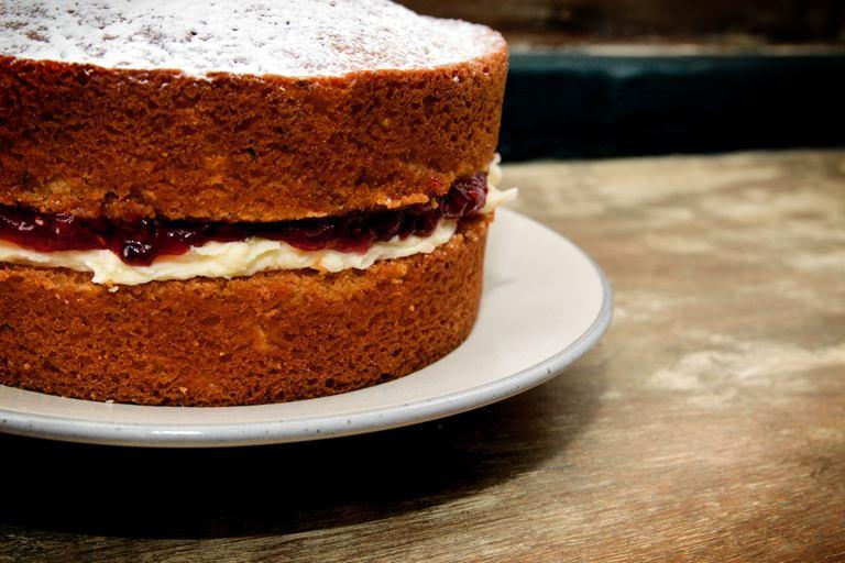 A classic, uncut Victoria sponge with a deep filling of butter cream and jam